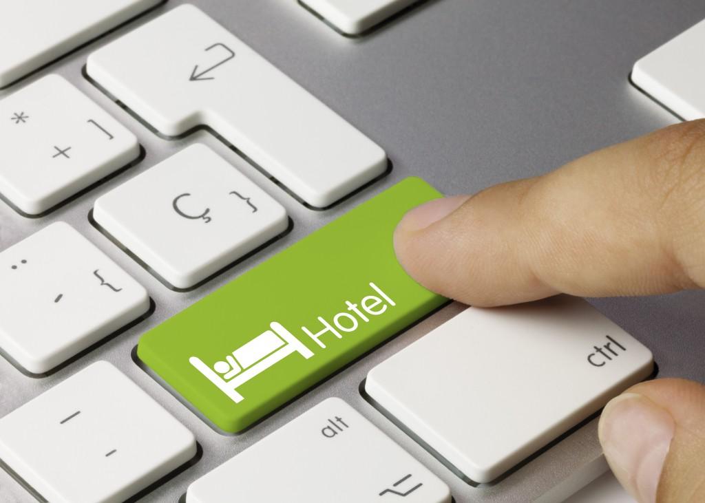 Hotel keyboard key. Finger